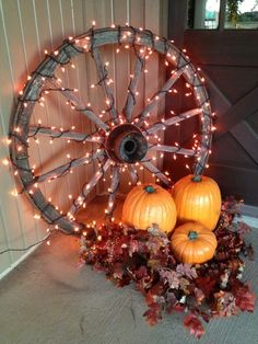 rustic style decor with a large wooden wheel covered with lights