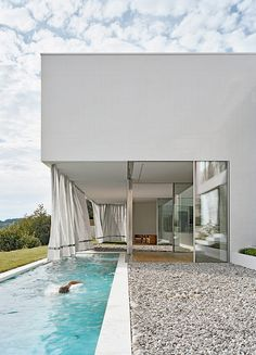 outdoor thermal drapes. KOR Architekten modern house design architecture