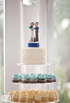 cupcake tiers-not this crazy topper, but I like the idea of a tiny cake that you can cut :)
