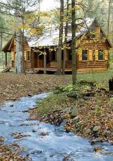 Ah, to have a cabin in the woods, a small stream, a fireplace, and lots of bookshelves.