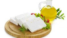 feta cheese(greek product) slices on a wooden serving board decorated with fresh vegetables and a bottle of olive oil Serving Board, Fresh Vegetables, Feta, Dairy, Food And Drink, Cheesecake, Recipes, Olive Oil, Buffet