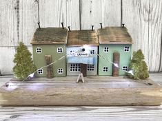 Original driftwood art by ontheTide 'Greens' I really wanted to call it 'Eat your Greens' but I thought that might be a bit too wordy! Lovely little wood houses made out of reclaimed wood have all been painted in varying shades of green, ideal for anyone who loves green decor! The shop