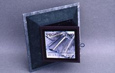 Pyramid Box and accordion book of handcolored photographs