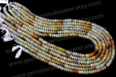 Ethiopian Opal Faceted Roundel Quality AA / by GemstoneWholesaler