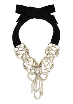 Golden-metal-necklace-closed-with-a-ribbon. CHANEL Versailles necklace. That bow rocks!