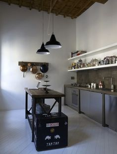 Like the cement gray backsplash, open shelves, lighting