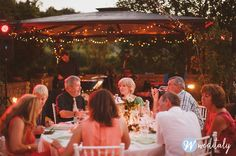 White linen, white Chiavari chairs, Edison lights, fairy lights LED lighting and silver lanterns by www.weditaly.com