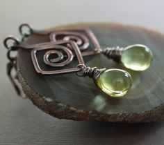 These elegant artisan copper earrings are made in Greek design swirls, hand forged with 14 gauge solid copper wire, embellished with lemon color Czech glass drop shape beads (10mm by 14mm in size) hanging from lever back (nickel and lead free) antique finish earwires. PLEASE NOTE: THE