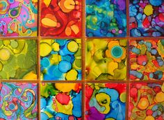 drunken tiles - alcohol inks and cheap ceramic tile.  So many fun uses for these... would be super cute as a trim in a child's bathroom!