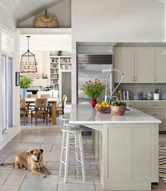 This kitchen island is painted Paris Rain by Benjamin Moore and topped with Caesarstone.
