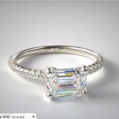 East-West pave setting from James Allen set with an emerald cut diamond.