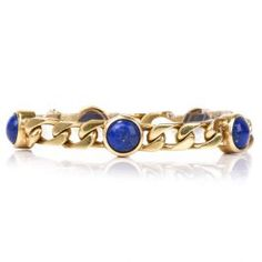 Vintage Lapis Lazuli Gold Link Bracelet This stylish vintage link bracelet is made of solid yellow gold and weighs grams. The bracelet is composed of link segments and adorned by 5 round cabochon lapis lazuli, measuring approx. Gold Link Bracelet, Link Bracelets, Antique Bracelets, Lapis Lazuli, Sapphire, Antiques, Rings, Vintage, Jewelry