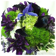 Wedding Flowers: Calla lily, green trick, hydrangea, roses, dahlia, variegated pittosporum Designs by Bobbie