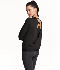 Long-sleeved yoga top in fast-drying mesh. Attached, open wrap-style section at back, and strap across back of neck. Ribbing at hem.
