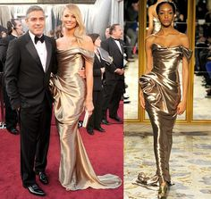 At the Oscars 2012 red carpet, George Clooney in an Armani suit with Stacy Keibler in a slick golden draped gown by Marchesa.