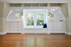 built in dressers below window with window seat nook