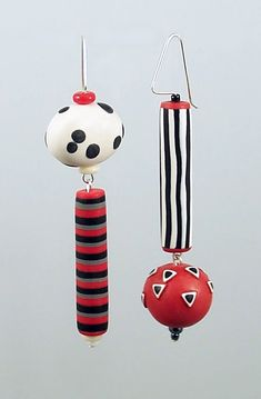 B&W Asymmetrical Earrings by Loretta Lam. A mismatched pair of polymer clay earring on sterling wire with accent glass beads.