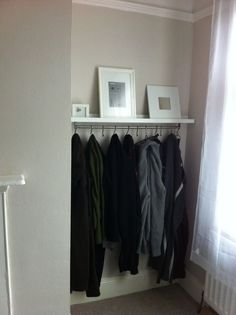 When hooks are attached underneath this rail it becomes a multipurpose piece of furniture in your bedroom or entryway: You can organize your jackets on the bottom and showcase artwork on top. See more at IKEA Hackers » - GoodHousekeeping.com