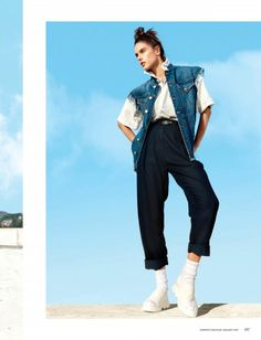 Striking a pose, Alessandra Ambrosio models Vivienne Westwood Anglomania denim vest, top and cotton pants with DKNY sandals