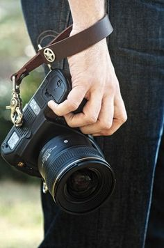 What a stylish but also useful way to keep track of our camera! It's right at our fingertips for capturing events!