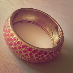 Gold with Pink Dots Bangle Bracelet Gold metal bracelet with pink enamel dots. Bracelet has a hinge opening Accessories