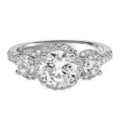 Regan: Three stone diamond engagement ring with petite prong set halo and diamond band. Style 31-V376FRW #ArtCarvedBridal