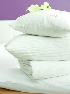 If your white bedding and towels are looking a bit grey and tired, add half a cup of lemon juice or a cup of white vinegar to your wash