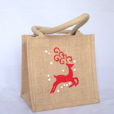 Reindeer Christmas jute gift bag, xmas gift bag, small burlap gift bag, hessian tote bag, add name on back- red & white tote bag by DestinationJute on Etsy https://www.etsy.com/uk/listing/256406019/reindeer-christmas-jute-gift-bag-xmas