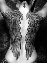 Black and white Angel's wing tattoo on full back