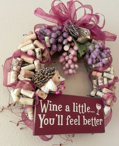 Charming Countryside Winery Wreath ...Wine a little...you'll feel better..sugared bejeweled grape vines, corks, hedgehog, bird. $50.00, via Etsy.