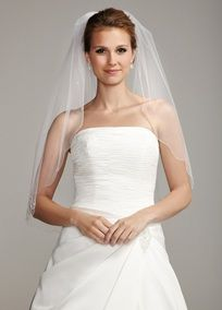"""Single tier waist length veil is accented with all the right details for a stunning look on your special day. Accented with a beautiful scalloped bugle bead embellished edge. Floral swirl design adds a modern twist. Meaures 32"""" long. Imported. Available in Ivory or White."""