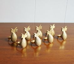 Vintage set of 8 brass pineapple napkin rings    Made of solid brass and polished to a high shine. In wonderful condition. Each one measures