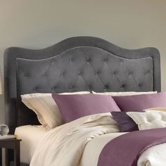 Love the head board. Not feeling the purple bedding, I' thinking blues, greys, and vibrant greens