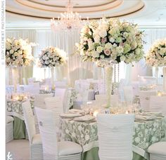 Tall Vase Centerpieces  Strands of crystals added bling to hydrangeas, roses and other cream, pink and green flowers. Votives at the base upped the romance at the tables.