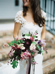 Get inspired: A gorgeous pink and deep purple bridal bouquet adds gorgeous drama to a simple lace wedding dress!