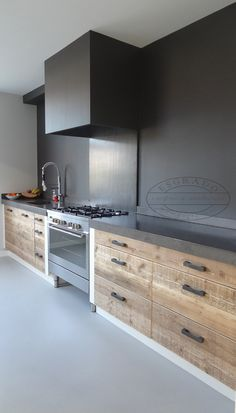 Love the color combination of cement counter top to wooden draws. Also love that stove is right next to sink.