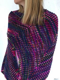 Polarstern is a star shaped feminine shawl worked in two-color brioche knitting, featuring a colorful foreground and a deep blue in the background. Polarstern is the German word for North Star. It was such a delight to knit this colorful yarn: as if I have had a rainbow on my needles! Repetitive increases and decreases give the shawl its unusual shape. Stripes appear by changing foreground and background alternately. The vareigated color is then worked as an applied i-cord for a clean…