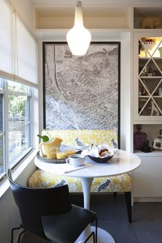 Hello Kitchen: Eat-in kitchen design with vintage French map art framing dining space. This space ...