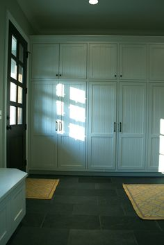 One of these lower closets in the mud room for extra shoe and jacket storage on opposite wall from lockers