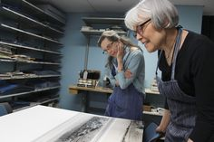 University of Washington conservators Kate Leonard, left, and Judith Johnson in the UW's Conservation Center at Suzzallo Library. Conservators repair and protect 10 thousand rare books, manuscripts, maps and other paper items every year.  #PhotoPreservation #BookPreservation #ezphotoscan
