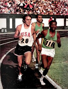 Steve Prefontaine races Ethiopian Mirus Ifter in the 5000m event of the Pan-Africa-USA International track meet, Durham NC, July 16, 1971 by The Happy Rower, via Flickr