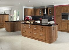 This is a kitchen in Walnut and a shaker style door. Walnut is a striking hardwood that has a unique grain and surface structure. It makes for a stunning kitchen design for those who enjoy the natural beauty of wood. Walnut Kitchen, Granite Kitchen, Kitchen Cupboards, Kitchen Tiles, Kitchen Design, Kitchen On A Budget, New Kitchen, Granite Worktops, Kitchen Worktops