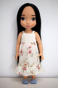 Disney Animators Collection doll Dress and Shoes. Why does Pocahontas look so sad? She's so sweet in this outfit!