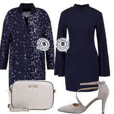 Questo outfit è composto da capi classici quali il tubino e il cappotto rivisti, però, in chiave moderna grazie al taglio particolare delle maniche del vestito e alla fantasia maculata del cappotto.
