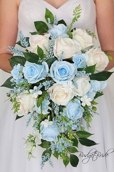 Cascading Teardrop Capri baby blue and white wedding flower brides bouquet with lilies orchids lambs ear seeded eucalyptus lily of the valley cherry blossoms lots of greenery in these silk artificial wedding theme flowers Winter Wedding Flowers, Rustic Wedding Flowers, Flower Bouquet Wedding, Wedding Colors, Wedding Themes, Blue Flowers Bouquet, Blue Wedding Bouquets, Artificial Wedding Flowers, Blue Wedding Flower Arrangements