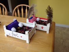 Stuffed animal pet beds decorated by 9-year olds.