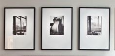 3 or 6 black and white photos over bed.