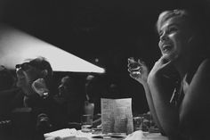 Beautiful shot of Marilyn watching Frank Sinatra on stage. Photograph taken at the Cal-Neva Lodge in 1960.