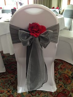 Charcoal with red was the scheme for this smart wedding set up...silver garland was used for the table runner and the chairs bows, only $3.95 each at alwayselegant.com More