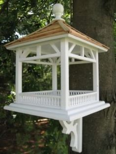 HB-2085 Features: -Bird feeder. -Classic Series Collection. -Victorian white color. -Perfect for just about any setting. -Constructed of exterior grade ply-board, and topped with a pine shingle roof. -Large open area can be used with seed or can easily accommodate a piece of fruit for Orioles to enjoy. -Also available with a Dark Blue roof as HB-2085B. -Warranty length: 1 year. -Dimensions: 15'' H x 11'' W x 11'' D.